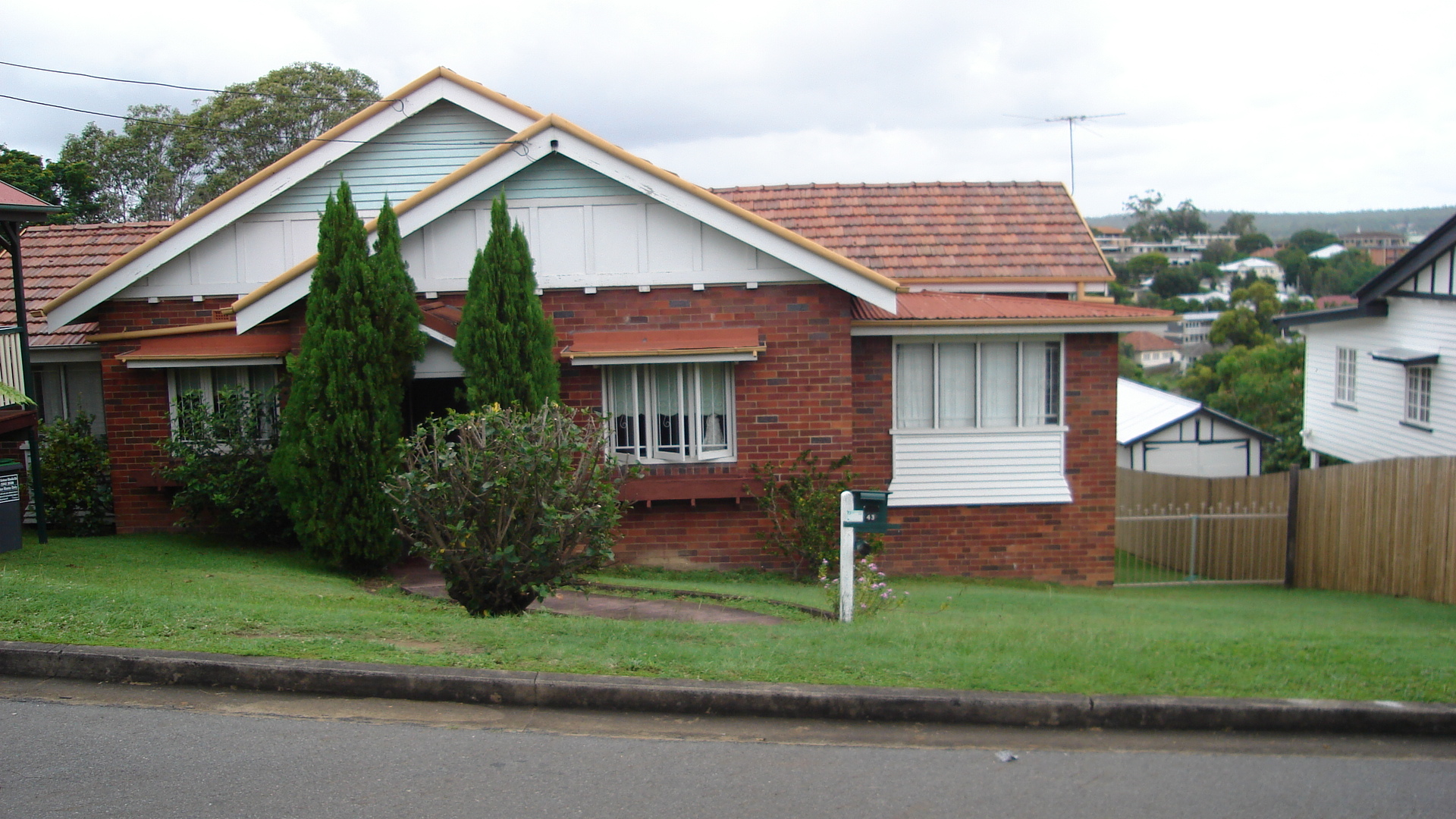 Before Renovation Snapshot Of A Red Brick Two Story House In Queensland